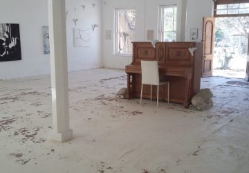 Helping cients to find purpose and meaning in Uncertainty- piano in empty white room.